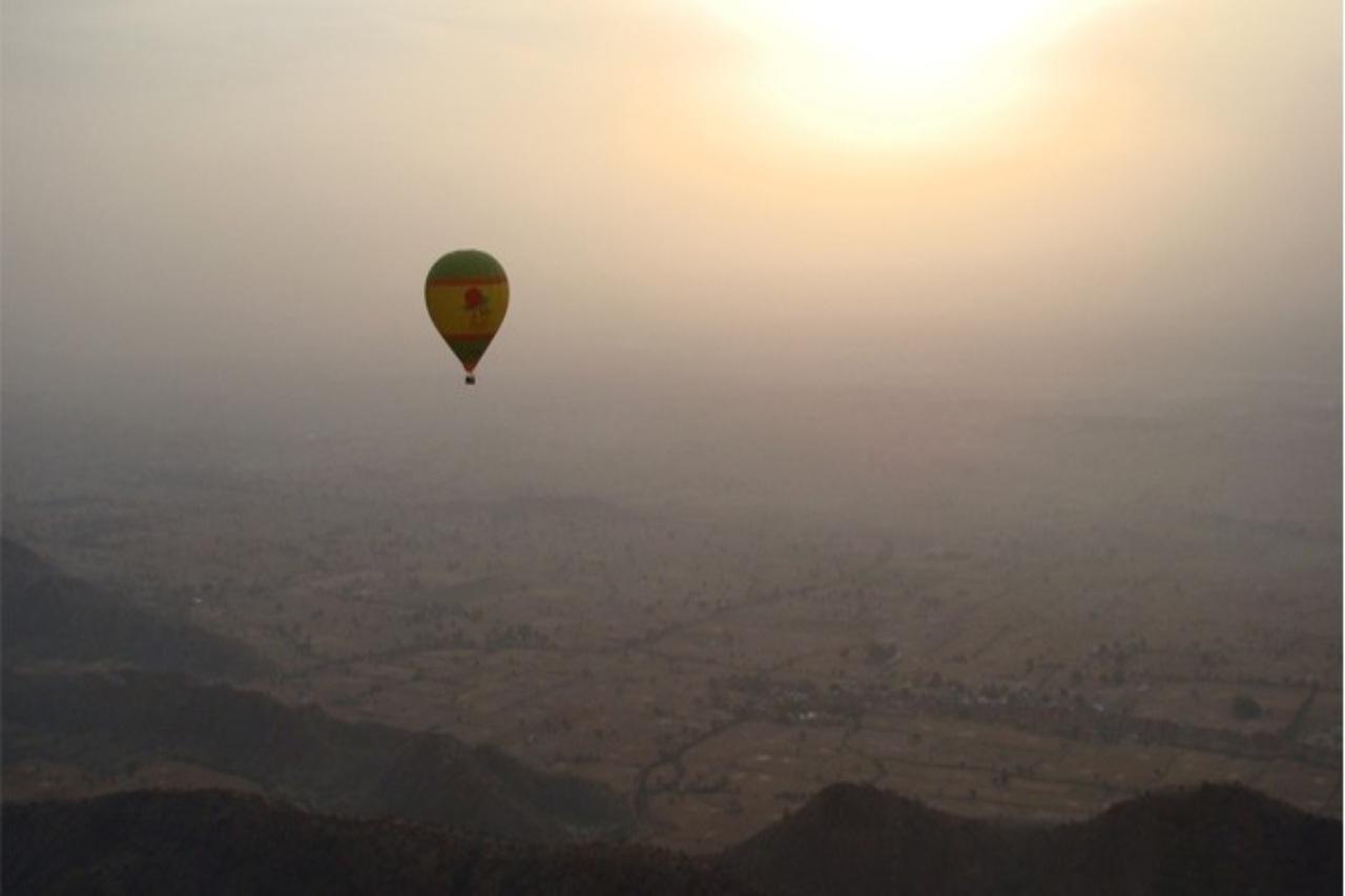A hot air balloon high above plains