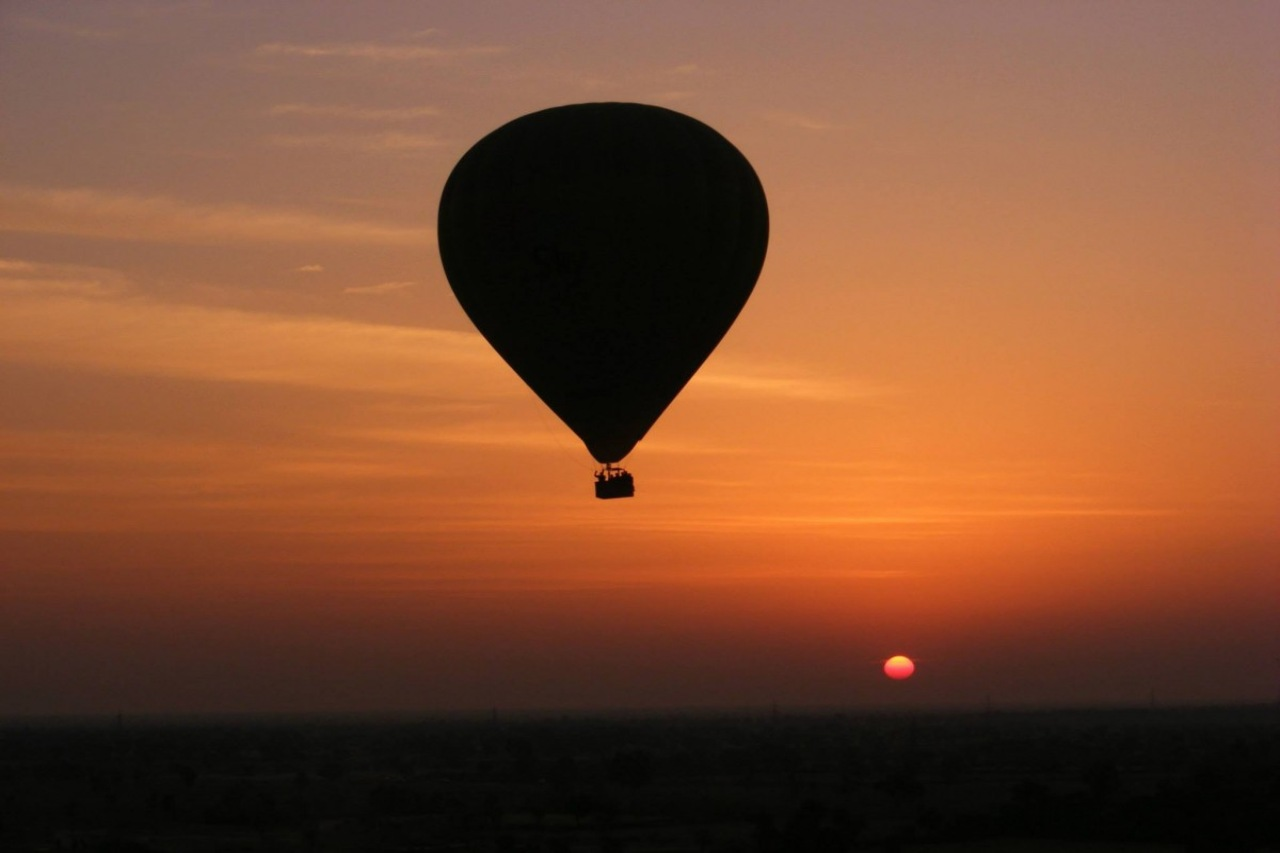A silhouette of a hot air balloon during sunset