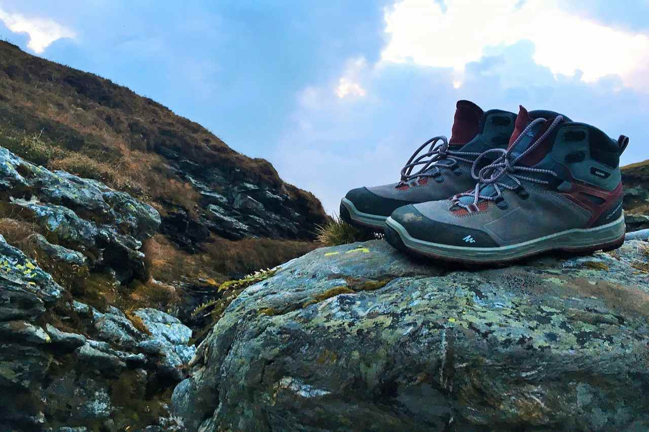 A pair of hiking shoes on a rocky boulder