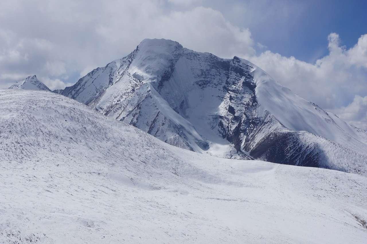 Snow laden path to a peak