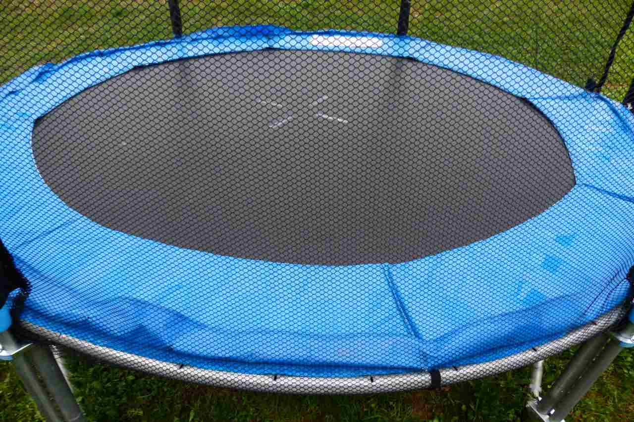A trampoline enclosed in a net