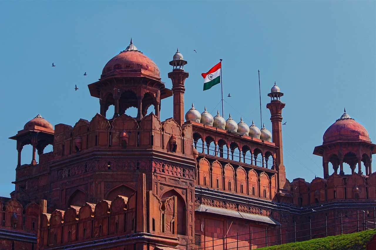 Red Fort with the tricolour waving out front.