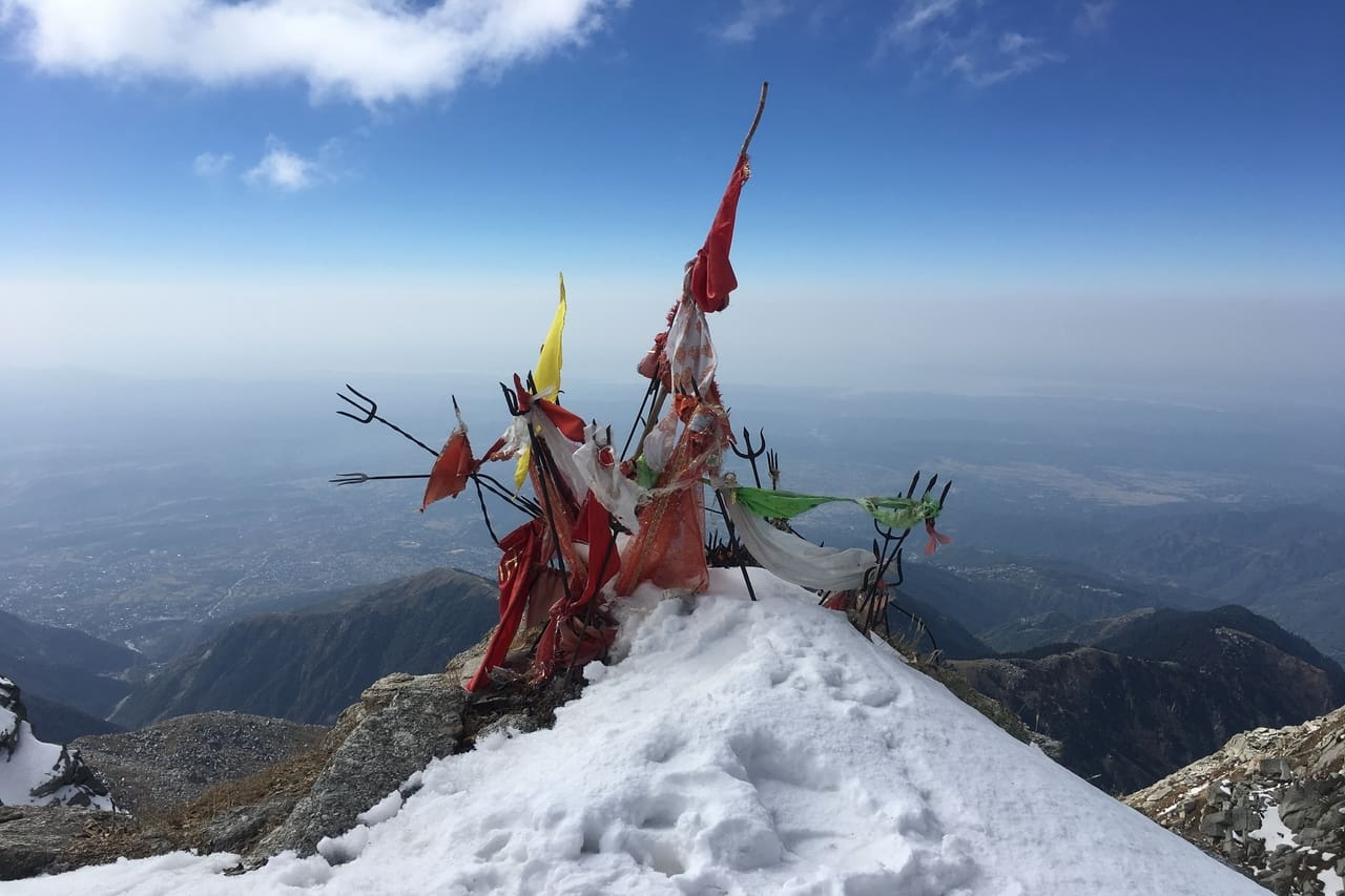 Religious tridents offered on a snowy peak