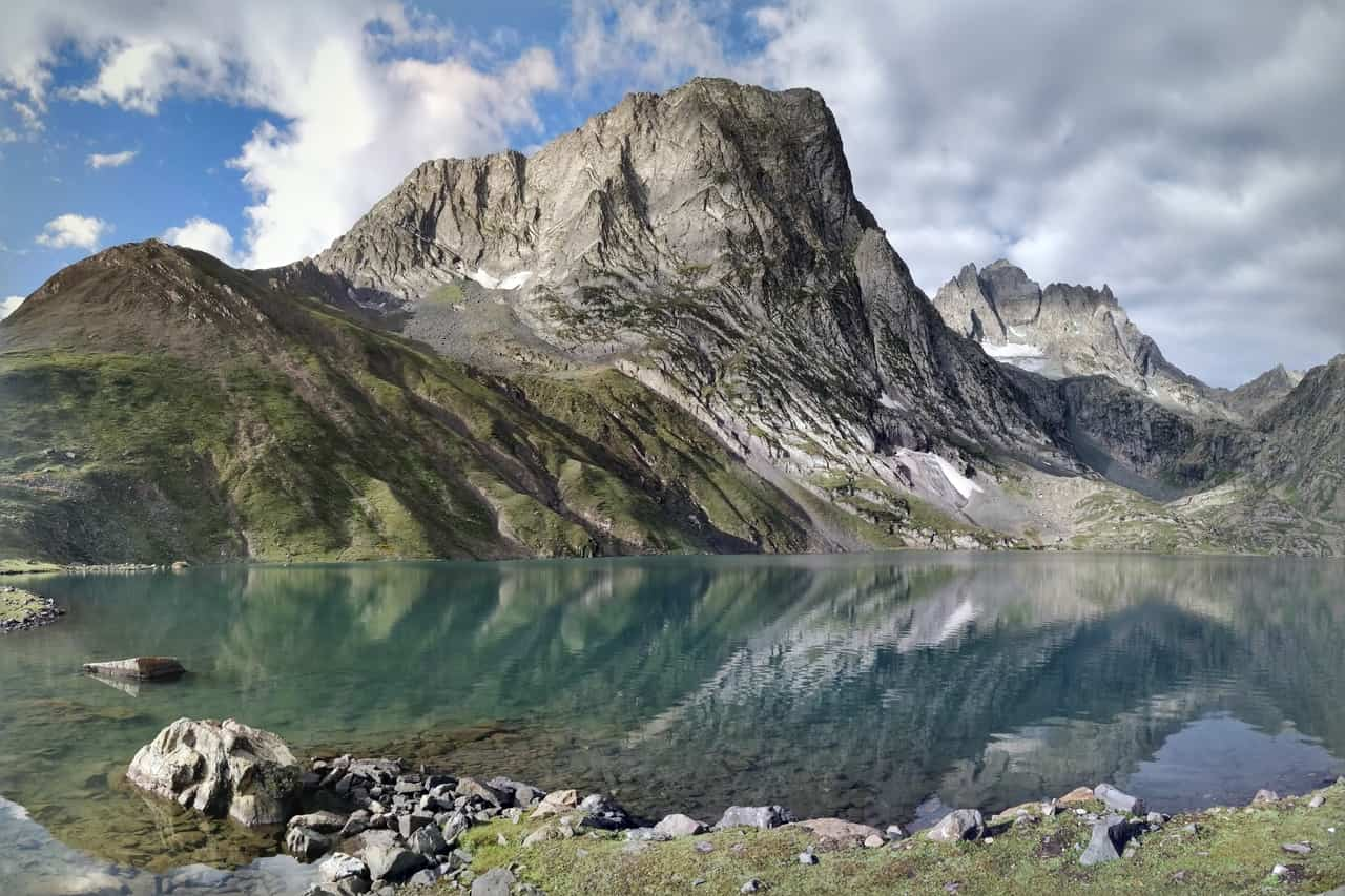 A rocky hill and its reflection on a lake