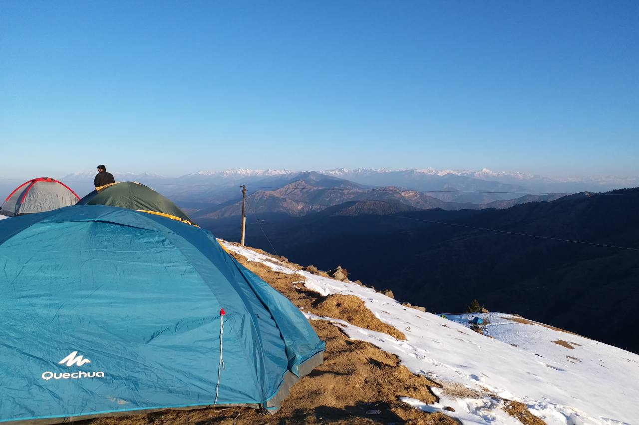 A campsite with a view of unending mountain ranges