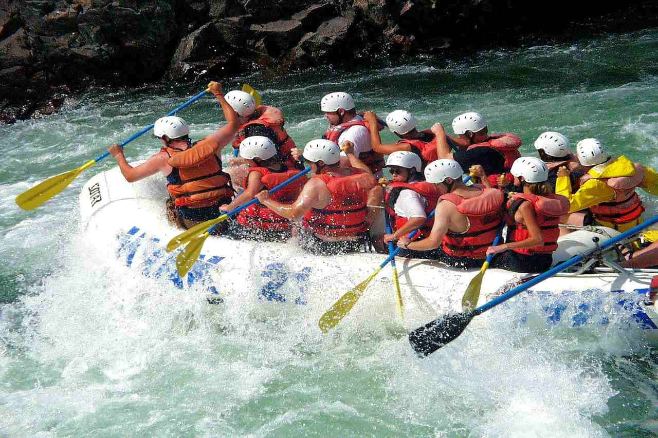 A packed raft boat on a churning river