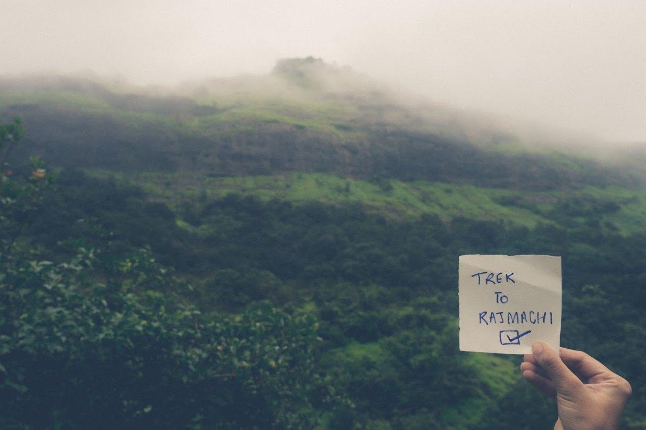 A checklist paper against a mountain.
