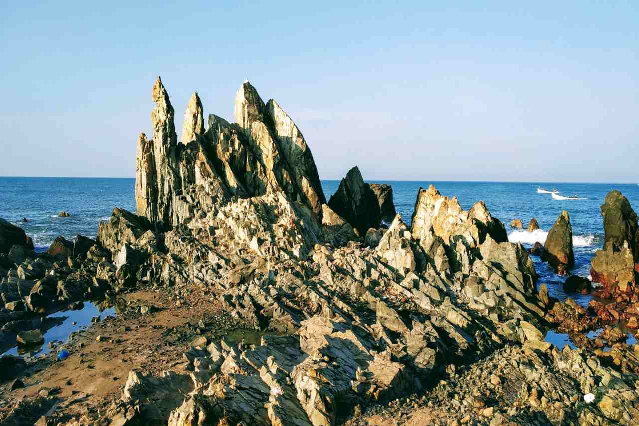A jagged rocky section on a beach.