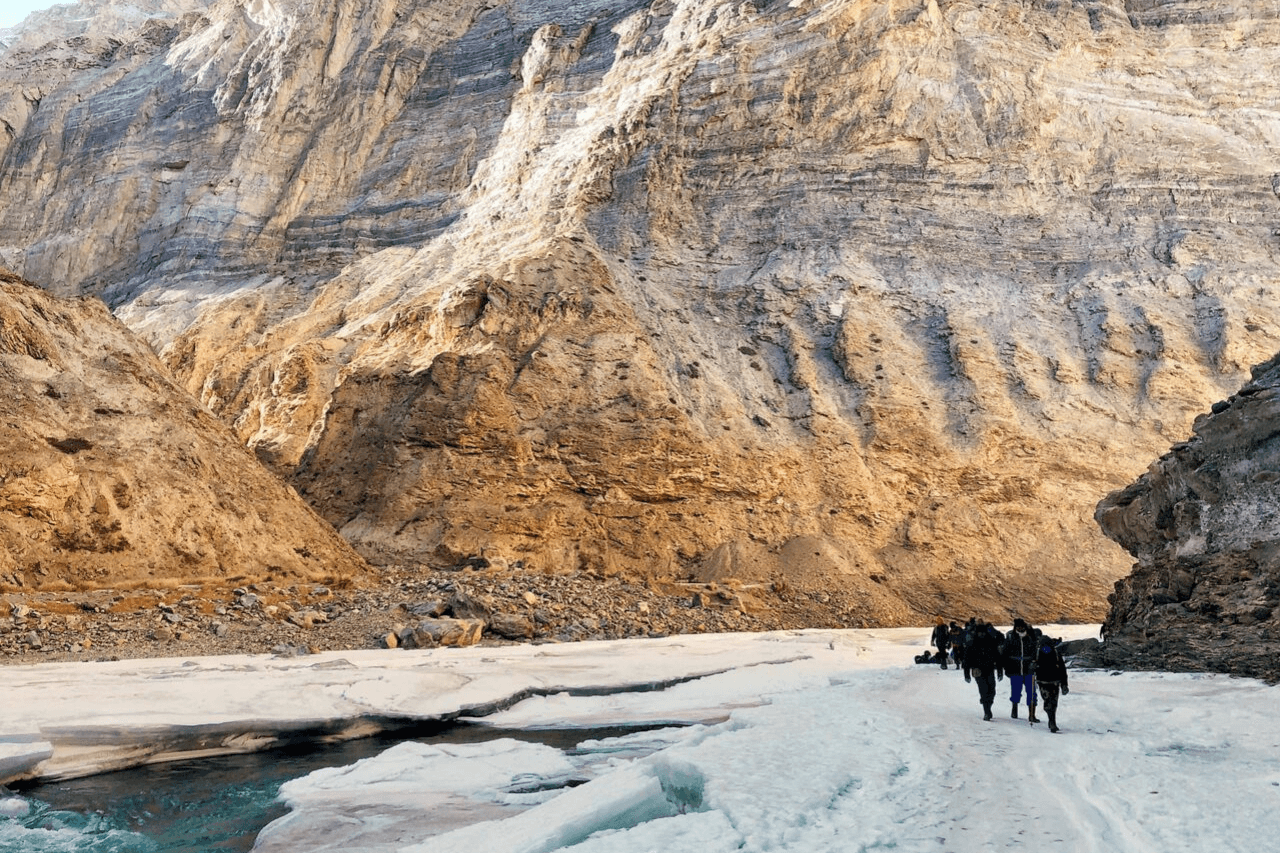 Group of trekkers walking on frozen Zanskar river on the Chadar trek