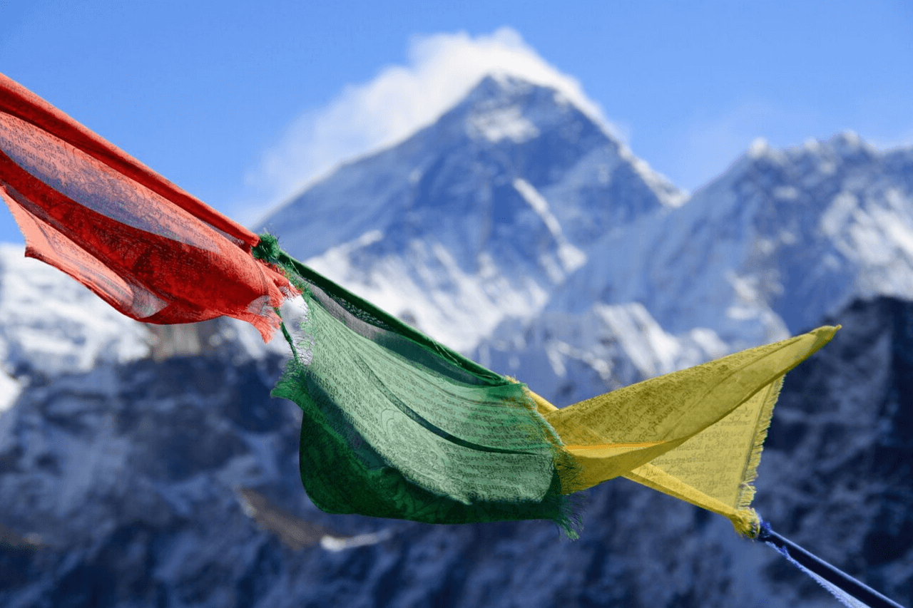 View of Mount Everest in distance with prayer flags in foreground