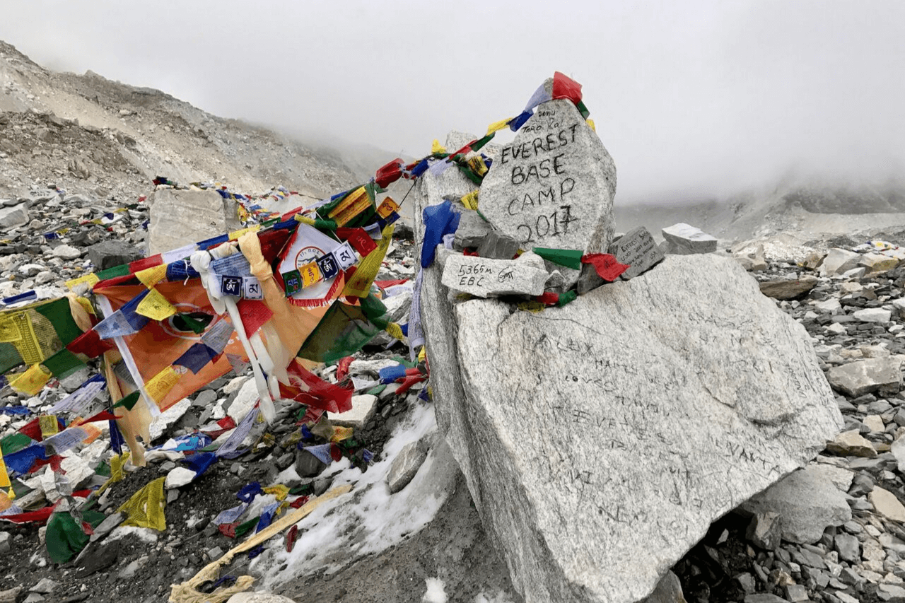 Colourful prayer flags tied around boulders at Everest Base Camp.