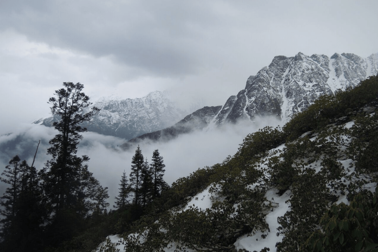 Mist rolling through valleys and peaks in the mountains.