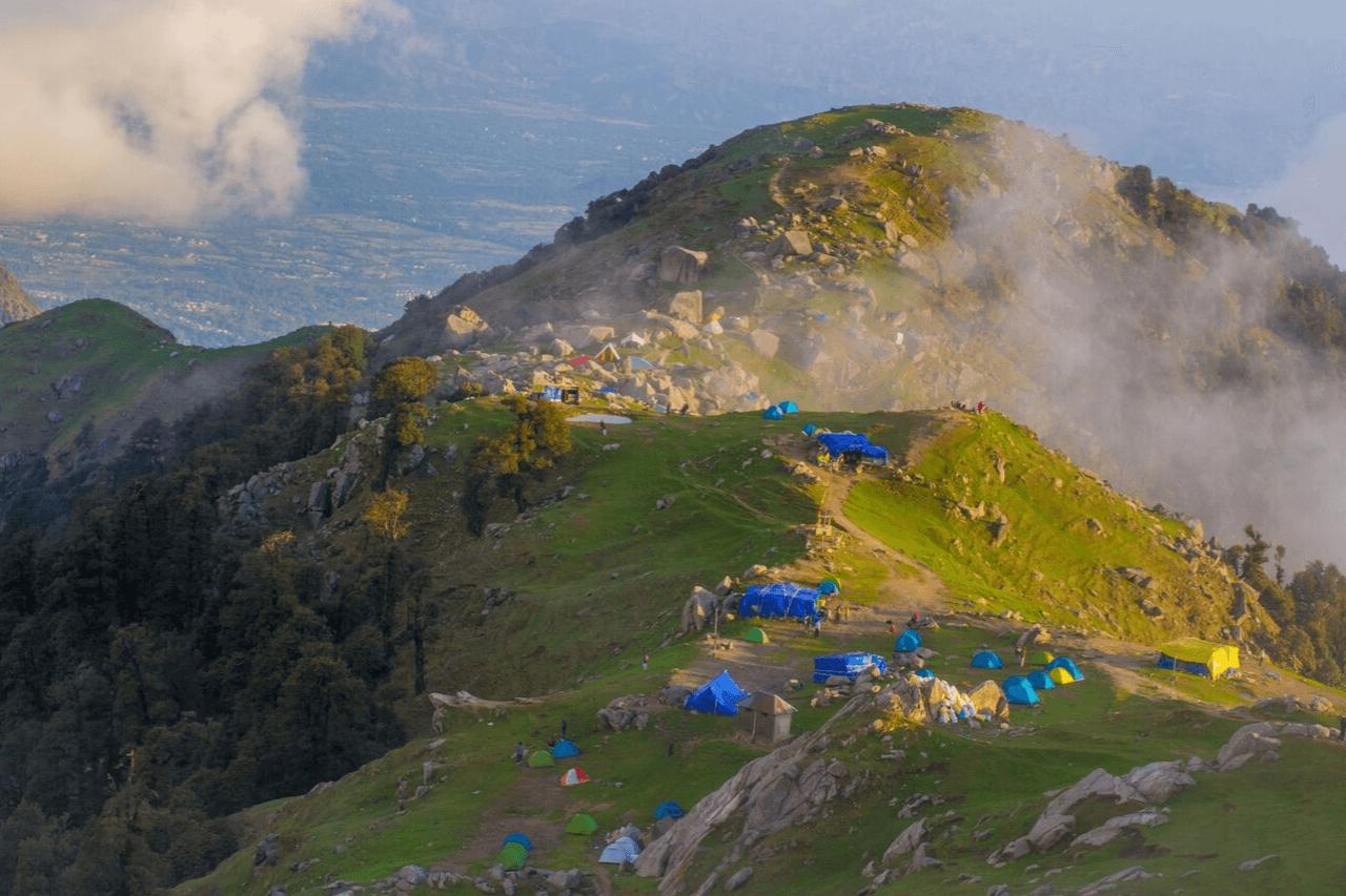 The evening sun illuminates the campsite at Triund top.