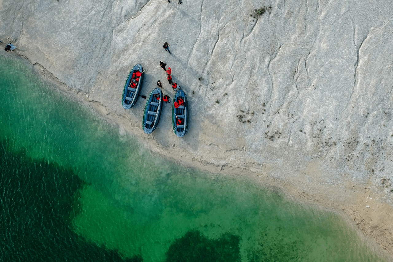 Aerial view of green river with white sand banks